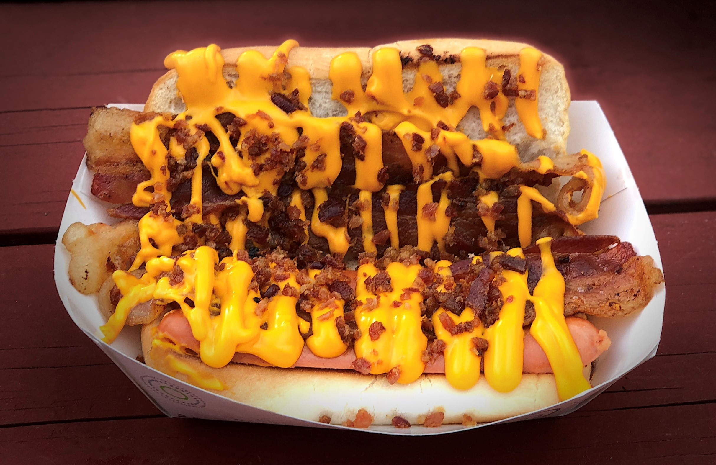 Pictured here:  Hog Dog Wiener featuring Bacon, Bacon, Bacon, Pepperoni, Cheese Sauce.